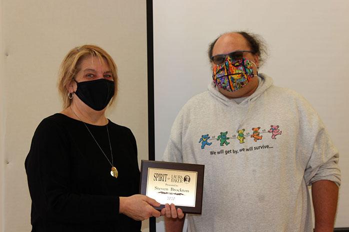 An Image of Steve Brockton receiving the Spirit of Laura Baker Award from Sandi Gerdes